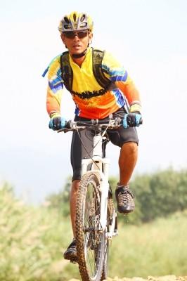 image of man on mountain bike