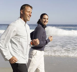 image of couple walking on beach