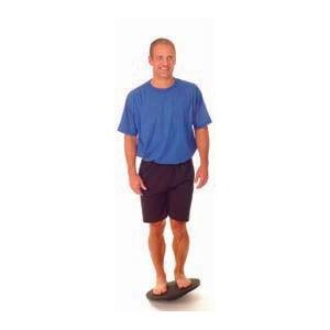 man standing on wobble board