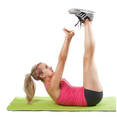 image of girl performing vertical leg crunch